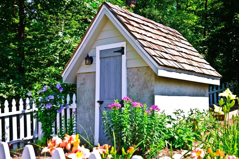 small garden shed with flowers