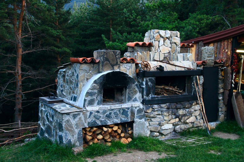 Gorgeous stone fireplace, pefect for your dream outdoor kitchen!