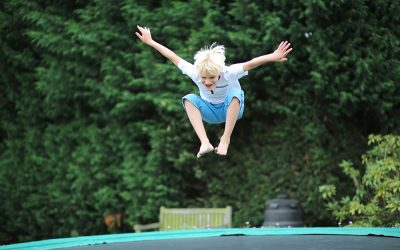 young boy jumping on the trampoline