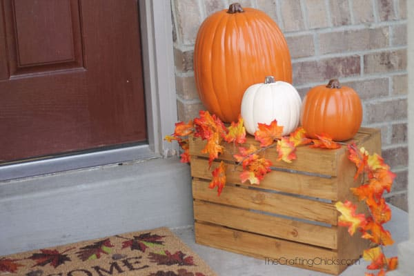 Autumn porch decorated with pumpkins