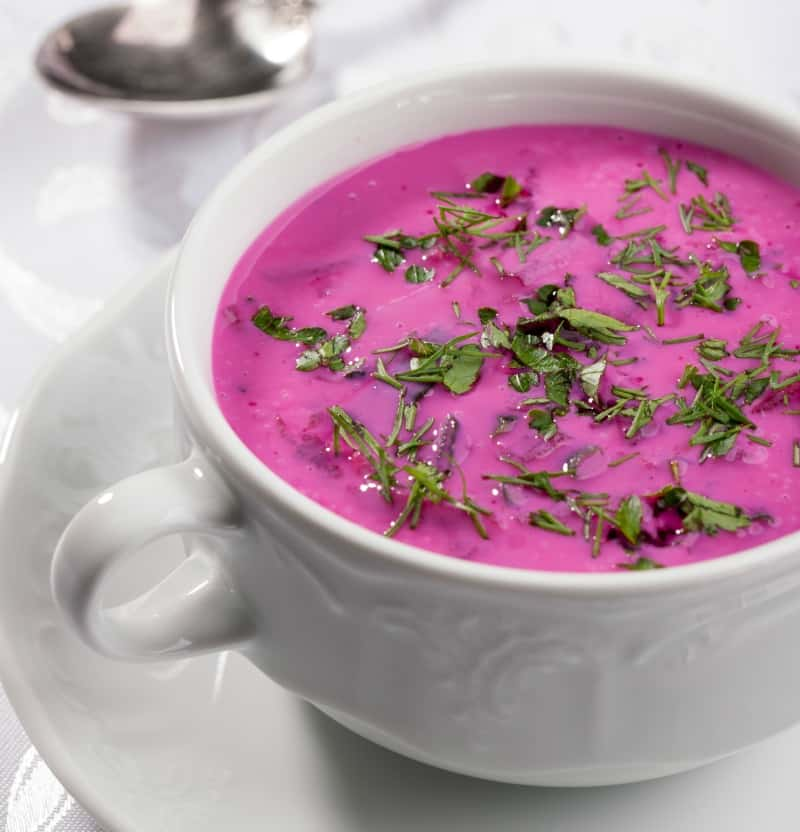 Cold beet soup in a white bowl