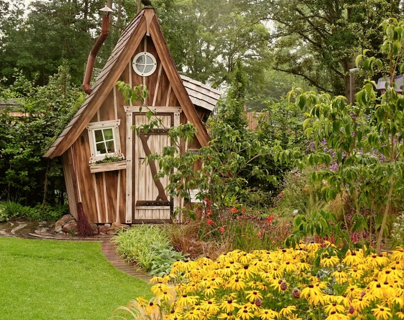 Cedarwood shed surrounded by flowers