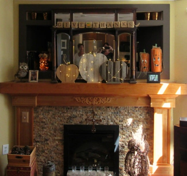 Harvest mantle - decorated with rustic pumpkins make of recycled wood