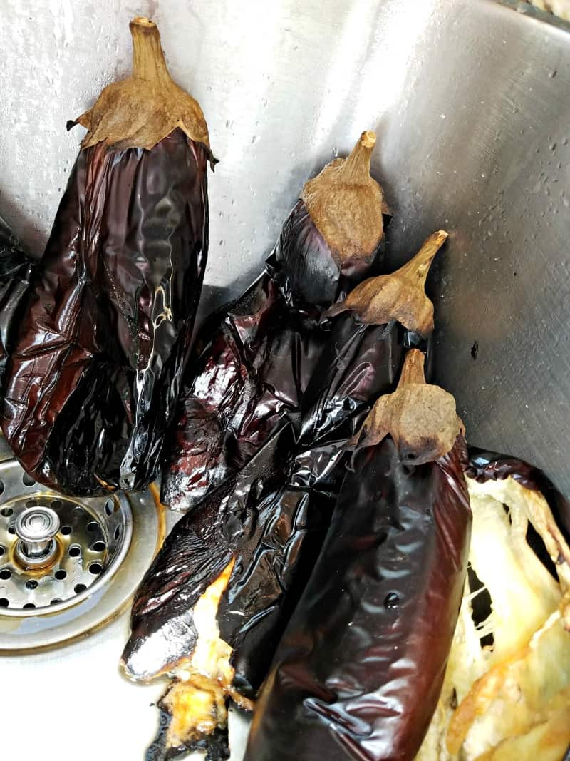 Roasted eggplants chilling in the sink