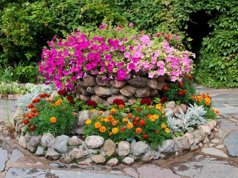 a flower bed made from big rocks