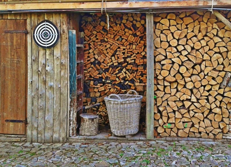 Firewoood shed filled up with wood for the winter