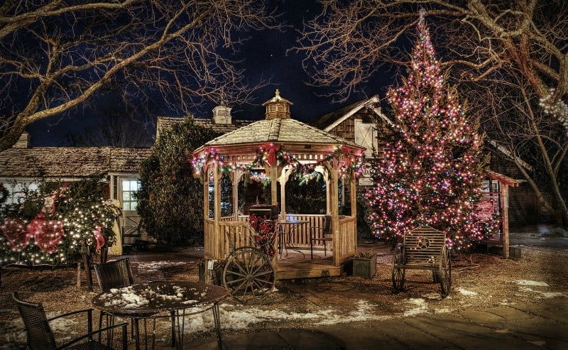 Lit up wooden gazebo in winter