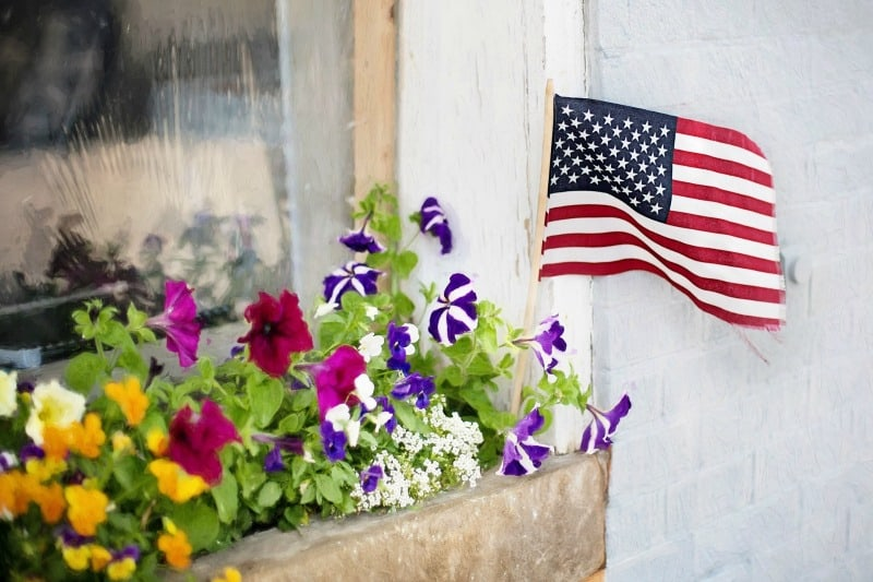 Fourth of July flowers and American flag