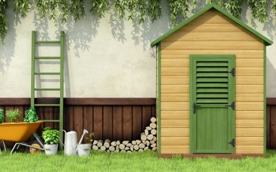 Beautiful backayard garden shed trimmed with green paint