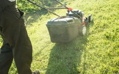 Man mowing uphill