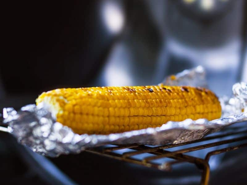 Baked corn in foil on the grill