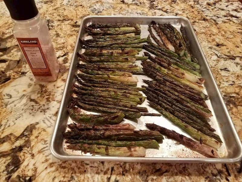 A tray of broiled asparagus