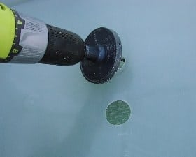 Drilling holes in a plastic bucket