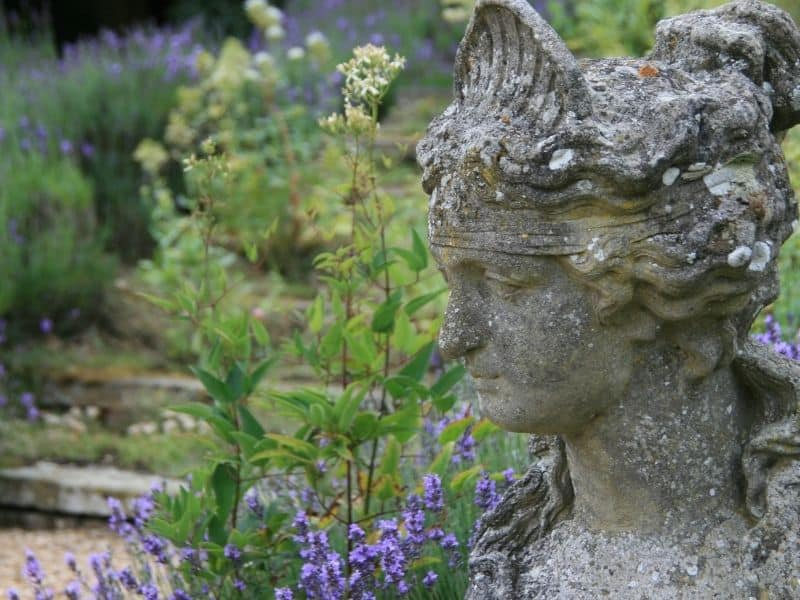 Old stone head statue in the garden