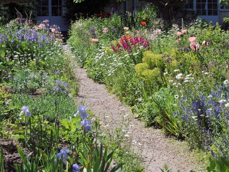 Gravel path through flower garden