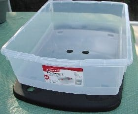 Rubbermaid container wiht holes, ready for creating a mini flow and drain system