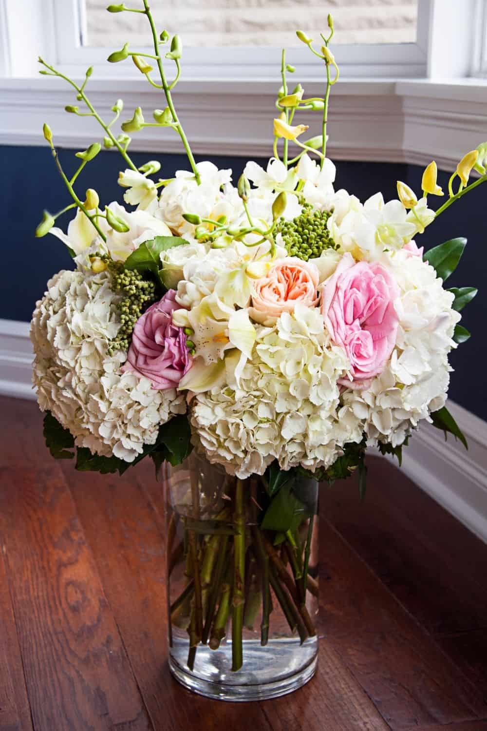 bridal bouquet featuring white hydrangeas and pink roses