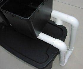 bucket sitting on pvc drain pipe