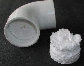PVC elbow stuffed with Styrofoam