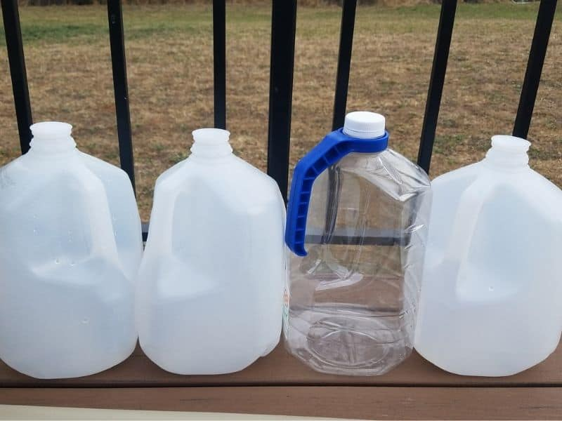 empty water jugs ready for winter sowing