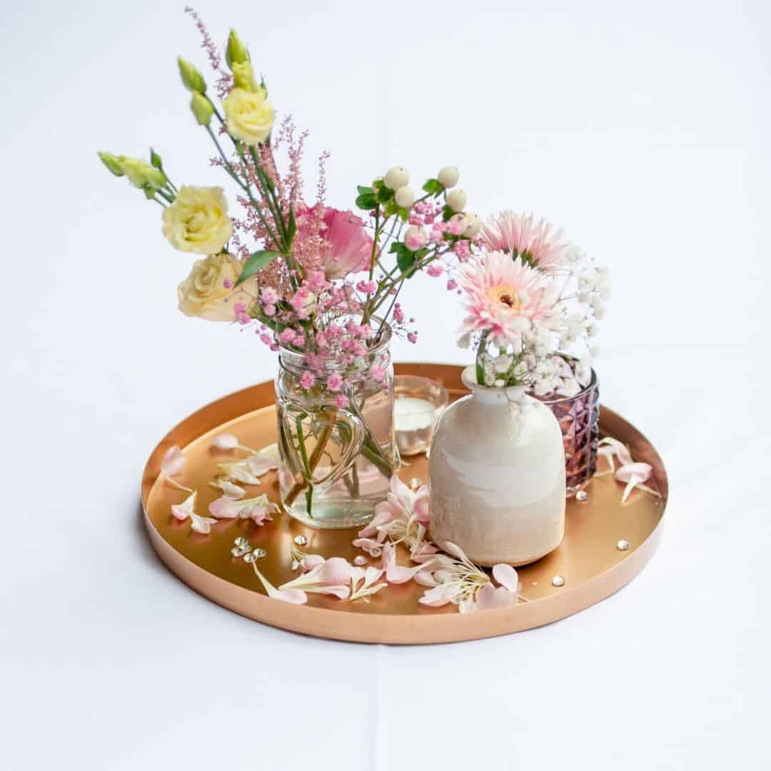 spring flowers beautifully arranged on a wooden tray
