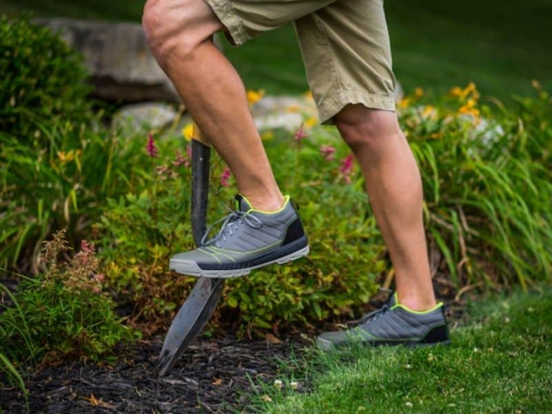 man wearing Kujo shoes diggning in the garden
