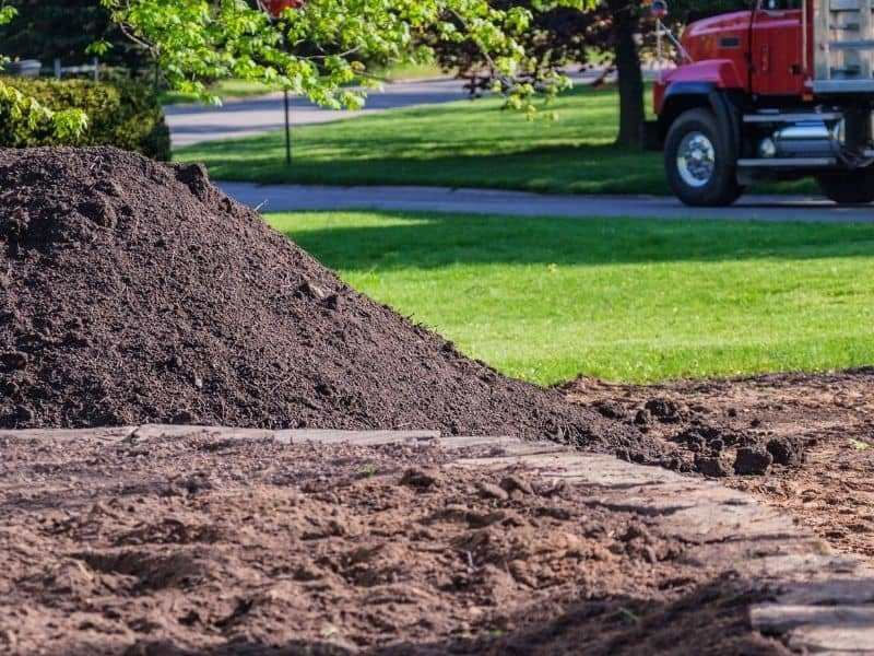 a pile of topsoil in the front yard