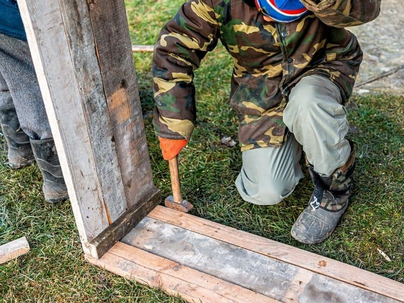 man building a box to use as a cold frame