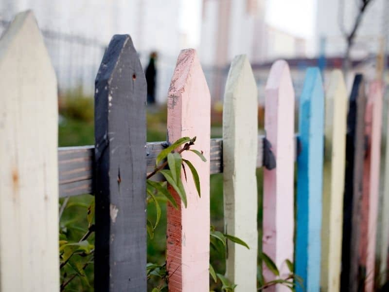 pastel colored recycled wood fence