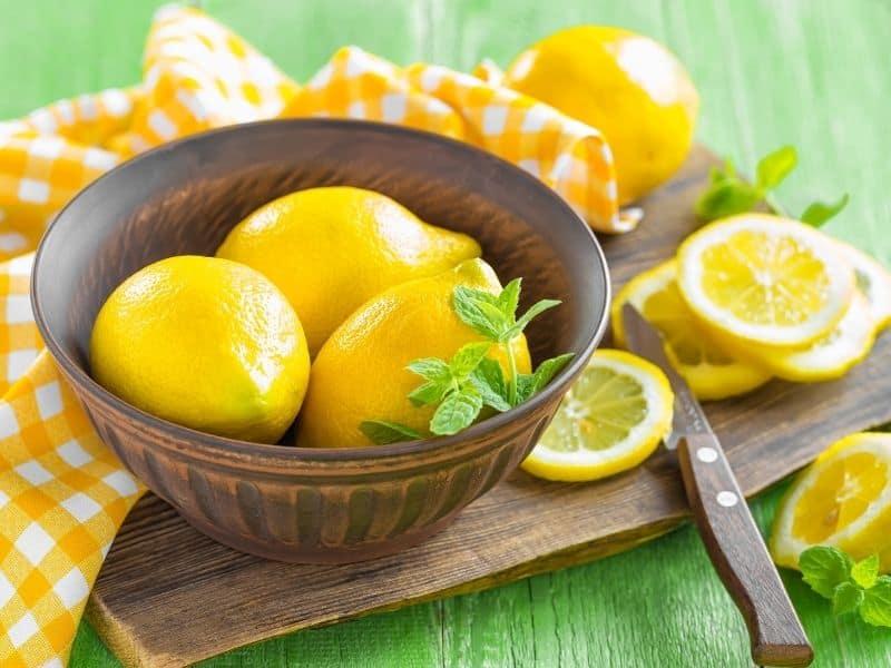 freshly picked lemons in a wooden bowl