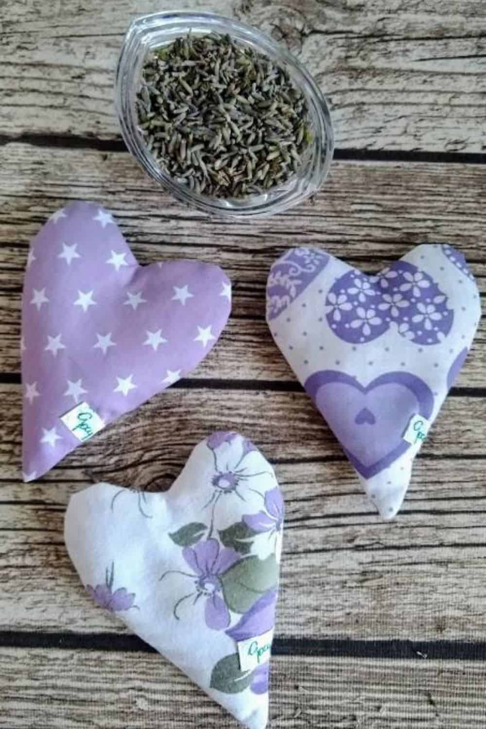 3 heart shaped pouches filled with lavender