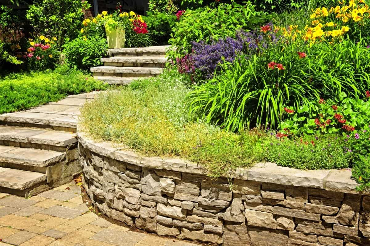 rounded retaining wall with a colorful garden above it
