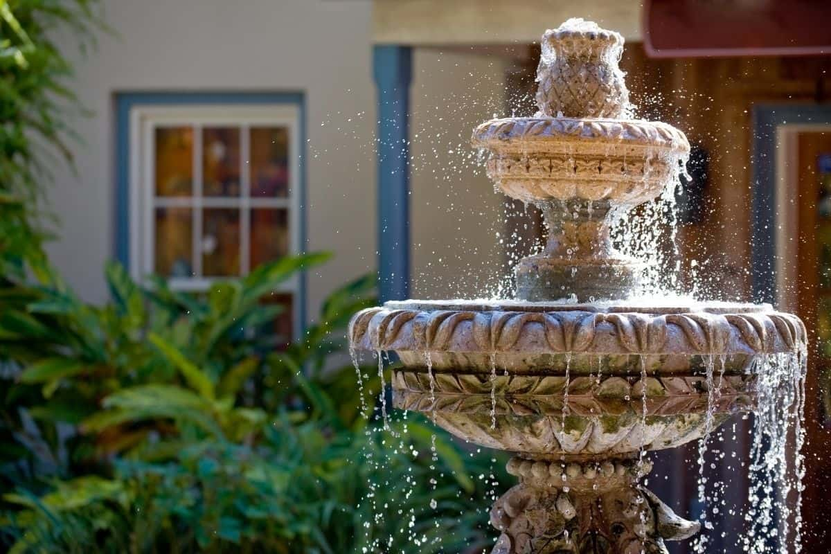 water fountain in front of the house